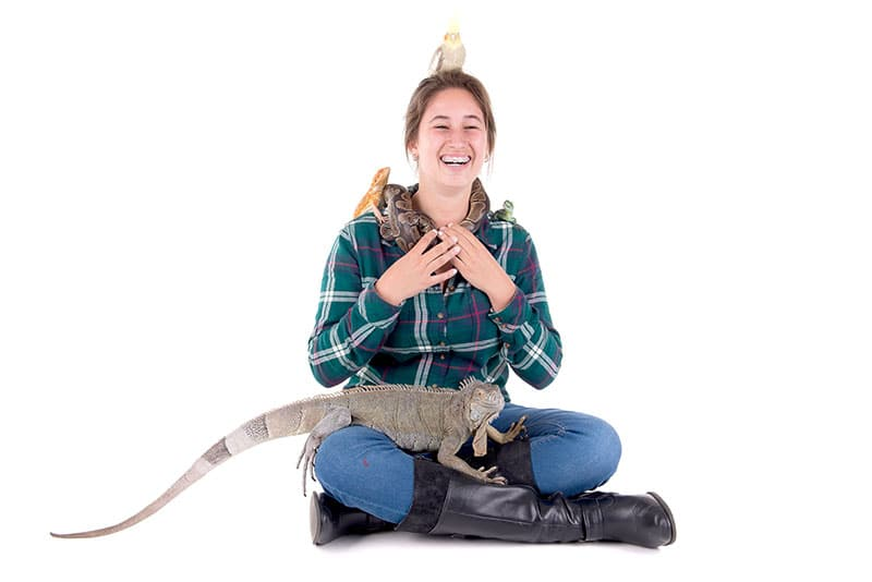 Girl surrounded by exotic animals